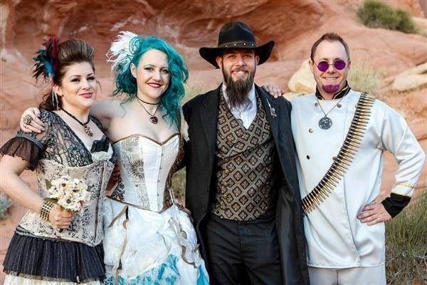 Steampunk couple with colourfully dressed wedding guests