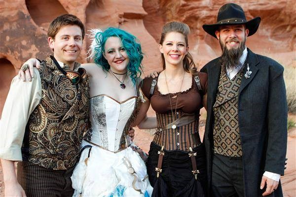Bride, groom and two guests all dressed in steampunk outfits