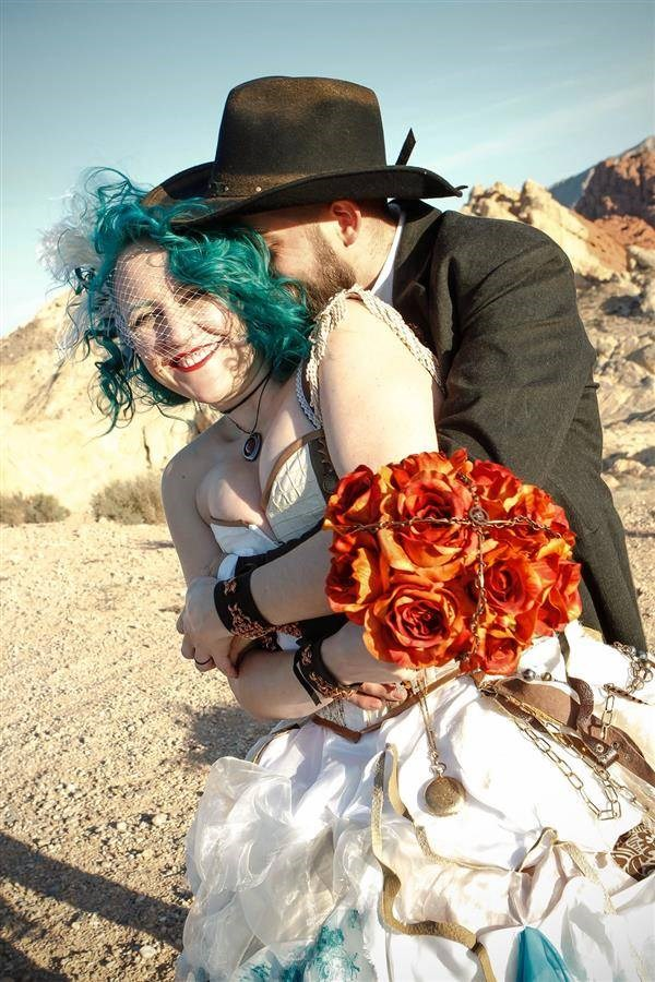 Alternative bride and groom hugging