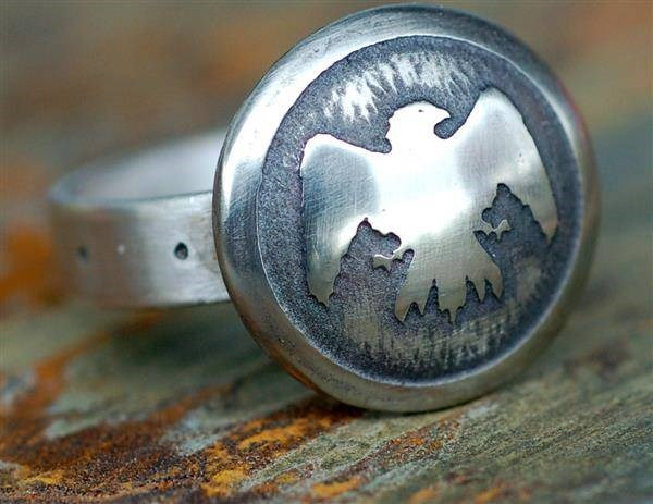 Closeup of Nights Watch etched silver ring