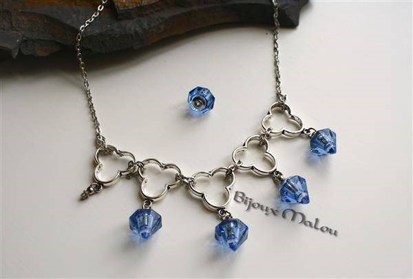 Silver necklace with blue screw-on poison chambers!
