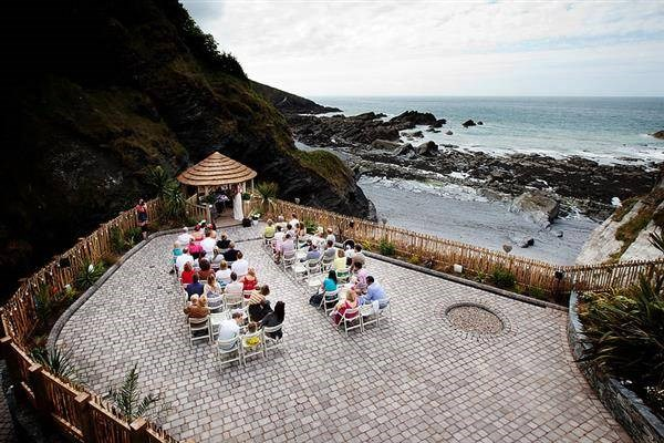 Wedding ceremony between the rocks by the sea