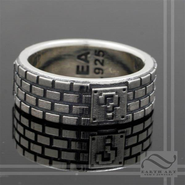 Solid silver Mario themed ring by Austin Moore