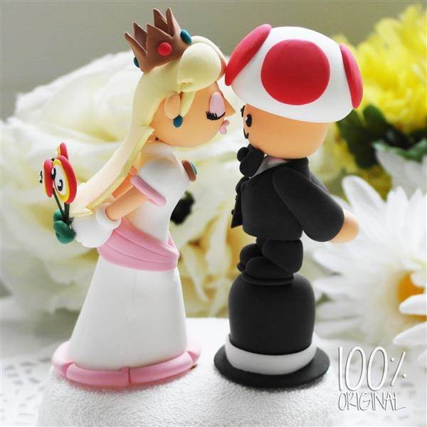 Custom made Princess Peach & Toad wedding cake topper by The Rosemarry Cake Toppers.