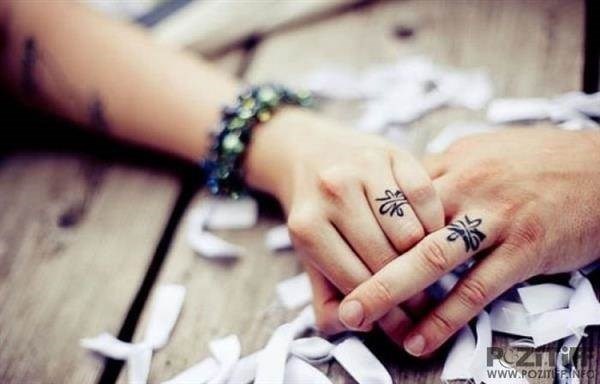 His and hers wedding ring tattoos.