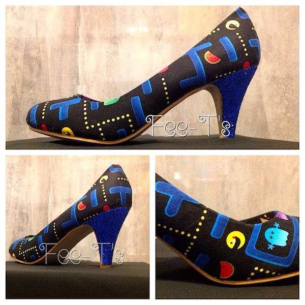 Pair of high heels wrapped in Pac-Man graphics.