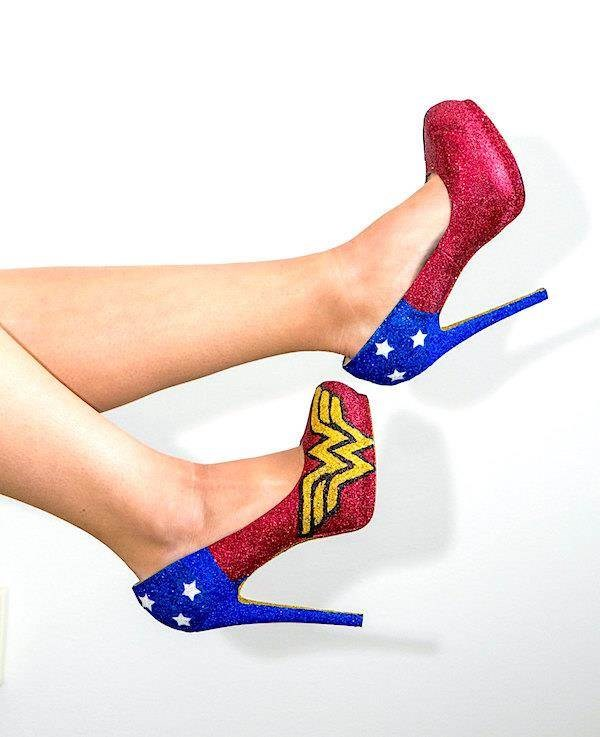 Woman wearing glittery Wonder Woman themed shoes.