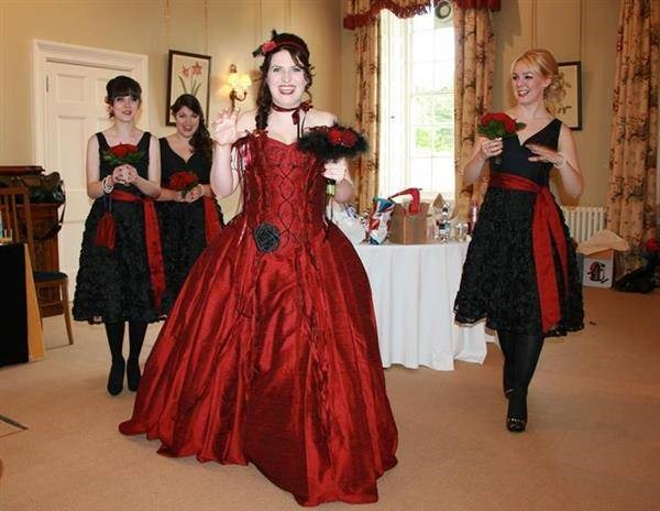 Bride in red Uptight clothing dress with bridesmaids in red and black