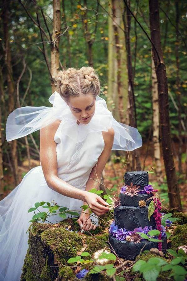 Bride with black wedding cake made by French Made