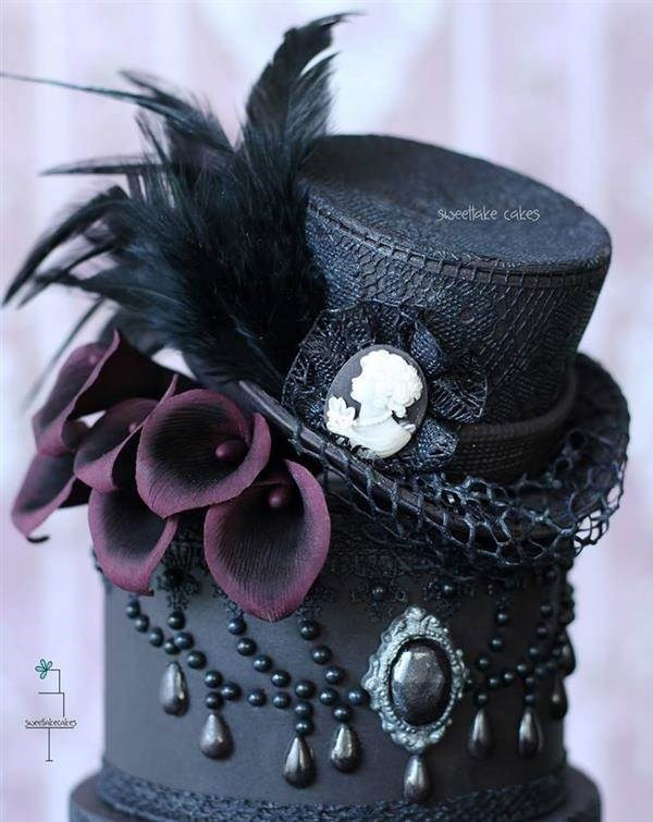 Black cake with top hat by Sweetlake Cakes