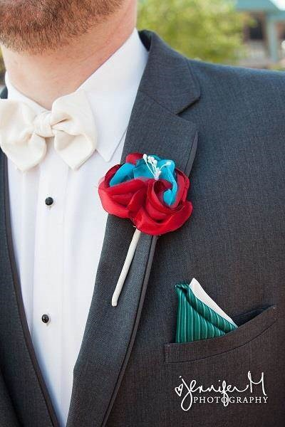 Red & blue buttonhole for a carnival wedding