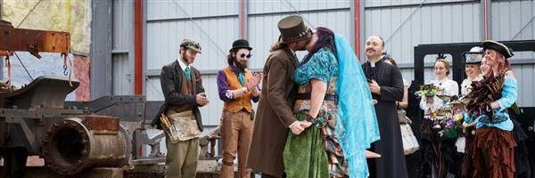 Steampunk wedding, bride and groom kiss