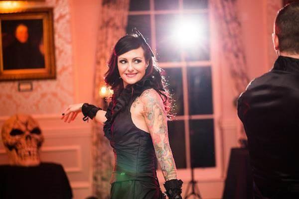 Tattooed bride dancing at her Halloween wedding reception