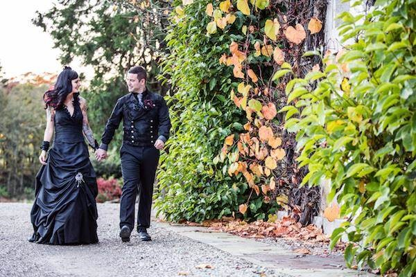 Gothic bride and groom taking a stroll at their Halloween wedding