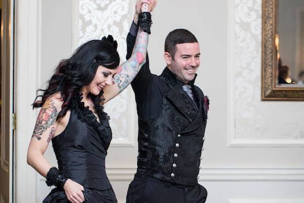 Tattooed bride and Gothic groom celebrating their marriage