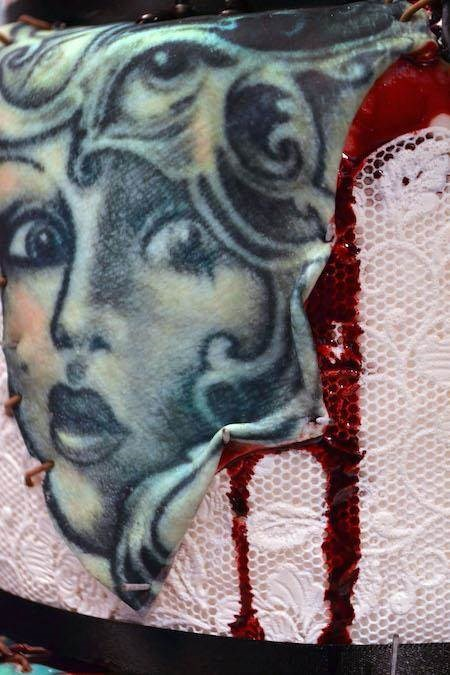 Close up of tattooed skin wedding cake