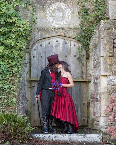 Gothic bride and groom kissing at Thornbury Castle.