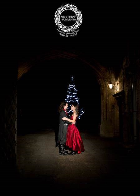 Night time shot of Gothic couple getting married at Thornbury Castle.