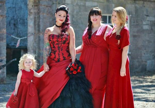 The bride and bridesmaids at her red and black themed wedding.
