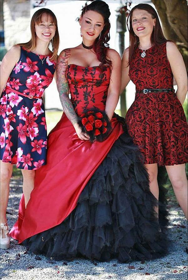Tattooed bride in her red and black dress