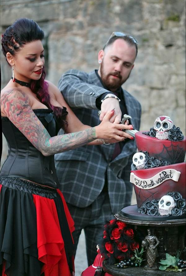 Cutting the Tim Burton inspired wedding cake