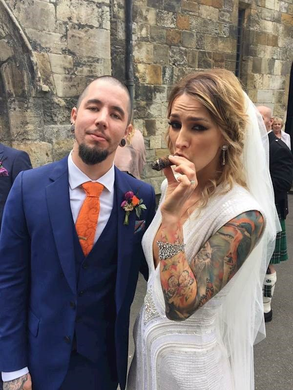 Tattooed bride relaxing with a cigar!