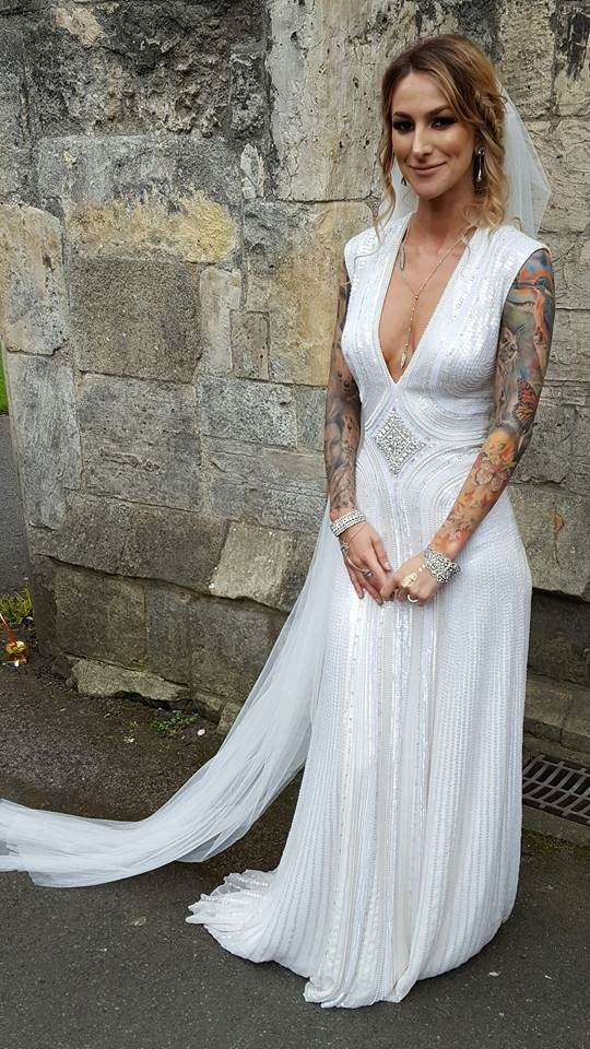 Tattooed bride in beautiful white dress.