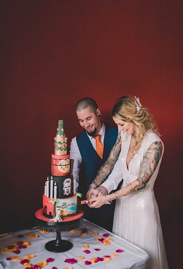 Bride and groom cutting their Lost Boys wedding cake.