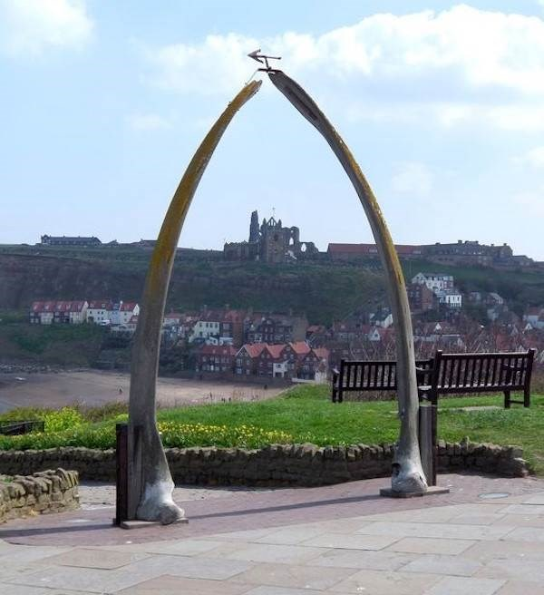 Whitby whale bones with Abbey in background