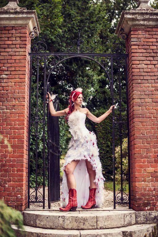 Bride Davina in her feather wedding dress.