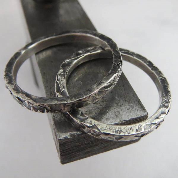 Set of his and hers wedding rings in beautifully textured oxidised Sterling Silver