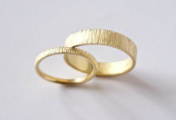 Unique his and hers tree bark wedding bands