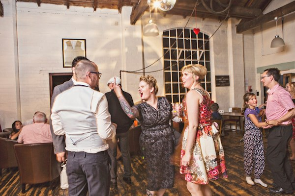 Flipping the bird at the wedding reception, photo by Lorna Lovecraft | Misfit Wedding
