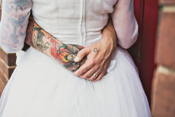 Tattooed bride and groom, photo by Lorna Lovecraft | Misfit Wedding