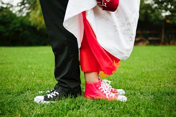 Bride and groom rocking Converse, photo by Lorna Lovecraft | Misfit Wedding