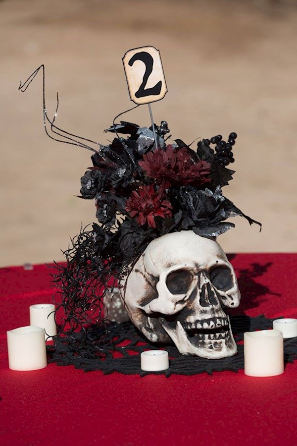 Skull centre pieces at a Satanic wedding | Misfit Wedding