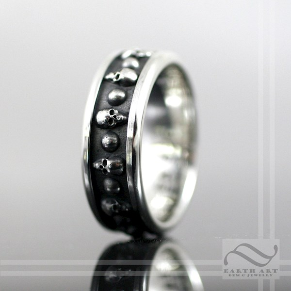 Repeating skulls design mens wedding band from Earth Art Gem & Jewelry | Misfit Wedding