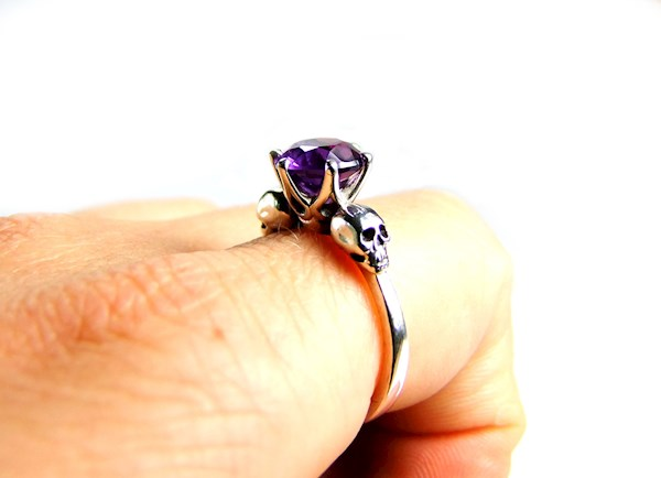 Alternative engagement ring featuring Amethyst and skulls from KIPKALINKA | Misfit Wedding