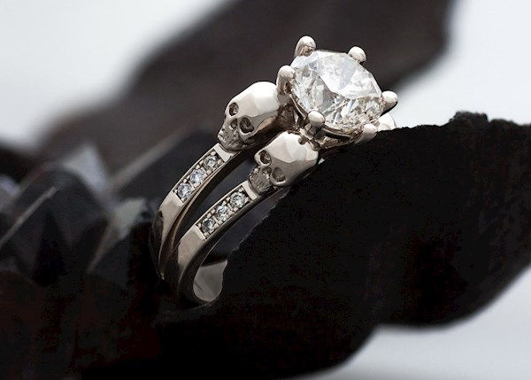 Luxury goth engagement ring with white gold, skulls and diamonds, from KIPKALINKA | Misfit Wedding