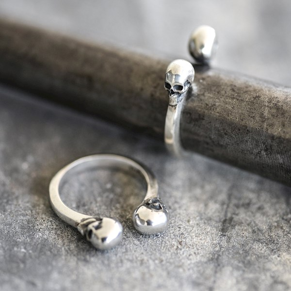 Handmade his and hers open cuff skull wedding rings from Nataly Avirame | Misfit Wedding