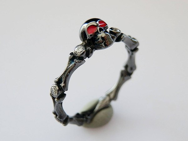 Bones and skull black and red goth wedding or engagement ring from Precious Metal Designs | Misfit Wedding