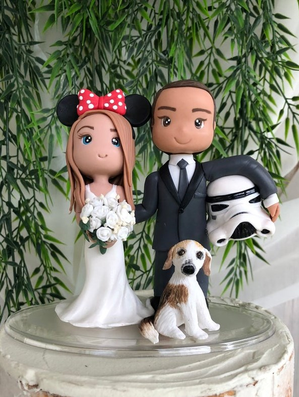 Customised wedding cake toppwer from Playcraft with Disney and Star Wars details. | Misfit Wedding