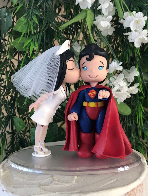 Naughty Nurse and Superman custom caketopper from Playcraft | Misfit Wedding